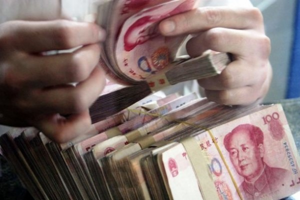China to cap overseas withdrawals using domestic bank cards